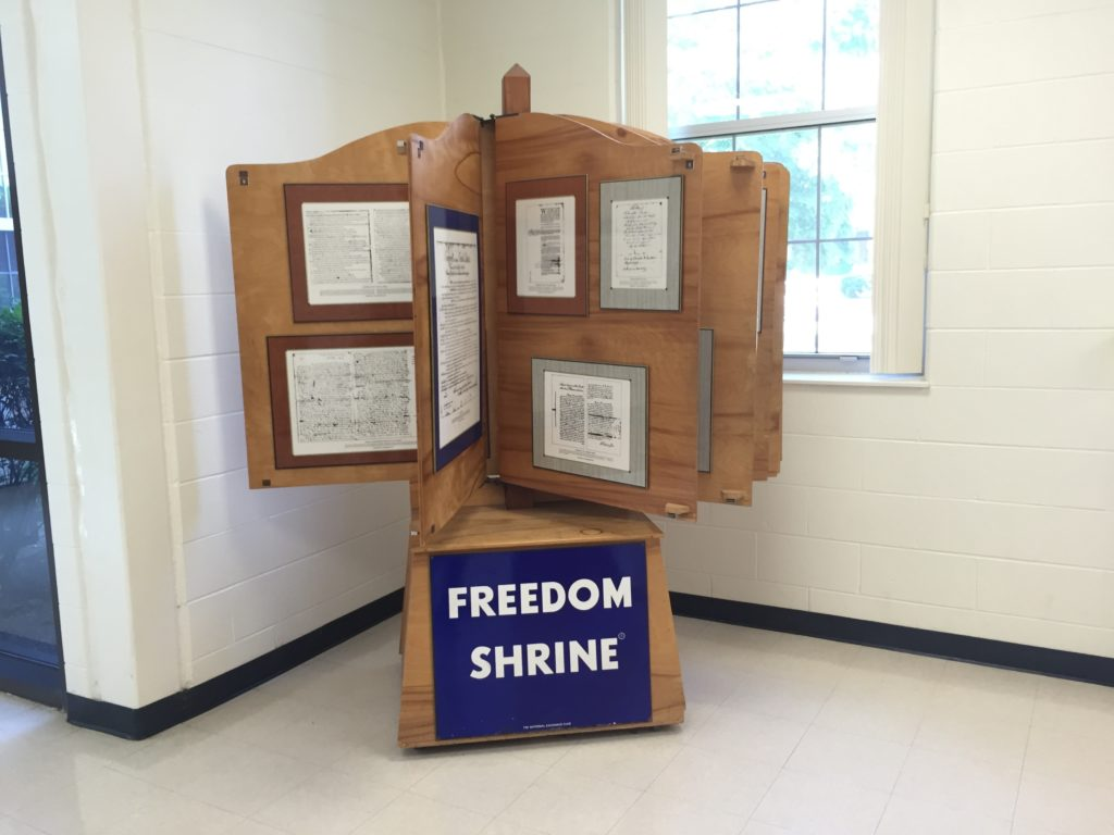 Display of documents related to Freedom at Marshall Middle School.