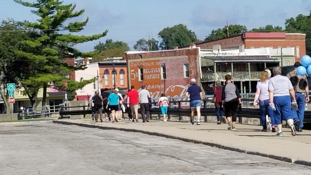 Coca Cola Mural in Albion Michigan and trail walkers