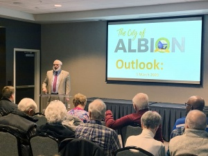 Mayor Dave Atchison presents a report of accomplishments and goals for the City of Albion to a group of about 125 people at the Courtyard by Marriott hotel on Thursday, March 5.