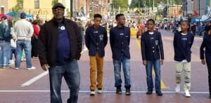 Ronnie Sims, a music teacher, led a synchronized marching routine with some Albion youth.