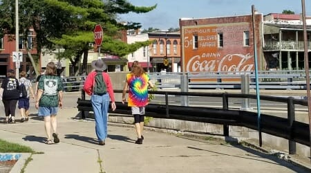Colorful tie-dye t-shirts in Albion Michigan by the Coca Cola mural