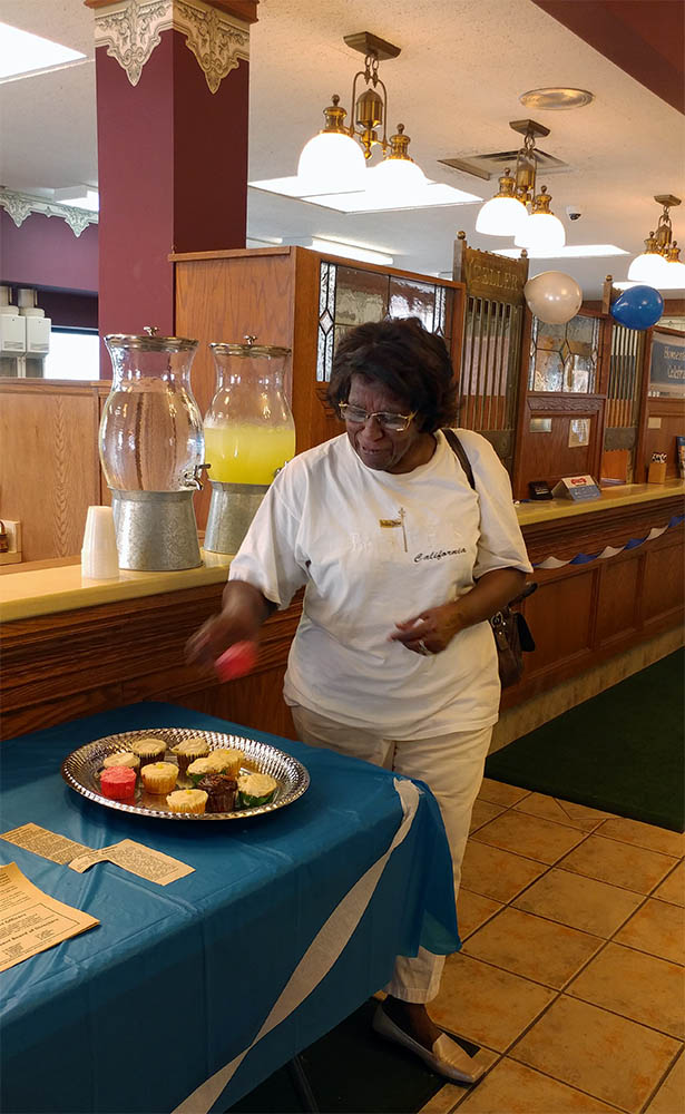 Essie Curtis enjoys a cupcake at Homestead celebration, Albion Michigan